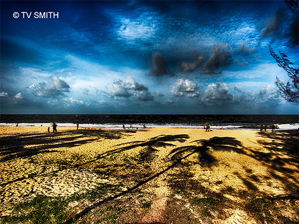 Sun painting shadows on windy Desaru beach